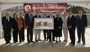 First page of Groundbreaking of the Integrated Science Building, UMass Amherst: cereminal             first shovel of dirt Group includes (left to right): Congressman John W. Olver (4th from left),             UMass President Jack Wilson (5th), UMass Amherst Chancellor John Lombardi (6th), Senator             Ted Kennedy (7th), UMass Amherst Provost Charlaena Seymour (8th), and Congressman Richard Neal (10th)