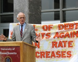 First page of Congressman John W. Olver in front of the UMass Amherst Student Union Building, speaking at             a rally against student loan debt