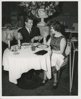 First page of Man lighting cigarette for June Trietsch Arzt at a restaurant