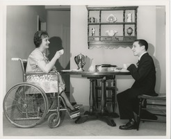 First page of June Trietsch Arzt in wheelchair and unidentified man with disability having tea