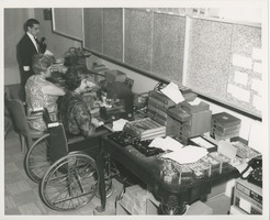 First page of June Trietsch Arzt operating an embosser in her wheelchair