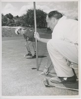 First page of Billy Bruckner posing at a golf course