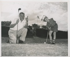 First page of Billy Bruckner and his father posing at a golf course