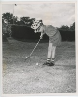 First page of Billy Bruckner swinging a golf club