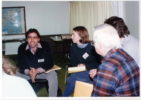 First page of Low-input Sustainable Agriculture (LISA) seminar: group seated at the seminar,             in conversation