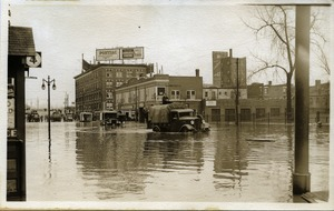 First page of Aftermath of the great Hartford Flood Relief trucks driving through flood waters, probably State Street