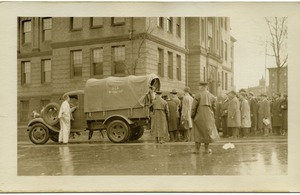 First page of Aftermath of the great Hartford Flood Crowd gathering near a National Guard truck
