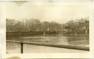First page of Aftermath of the great Hartford Flood Flood waters by McAlear Shell Station (61 Wells Street)