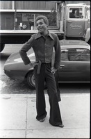 First page of African American man wearing trendy clothes, wide collar, and bell-bottoms
