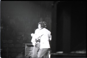 First page of Richard Nader's Rock and Roll Revival concert at the Springfield Civic Center:             Chubby Checker embracing Richard Nader at end of his performance