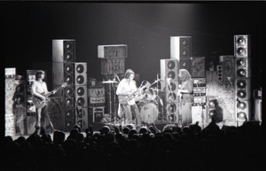 First page of Grateful Dead concert at Springfield Civic Center: band in performance in front             of a wall of speakers