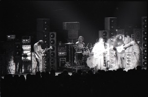 First page of Grateful Dead concert at Springfield Civic Center: band in performance in front             of a wall of speakers (spotlight on Bob Weir and Jerry Garcia)