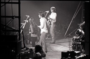 First page of Grateful Dead concert at Springfield Civic Center: band in performance: Donna             Godchaux, Bob Weir, Phil Lesh (l. to r.)