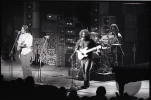 First page of Grateful Dead concert at Springfield Civic Center: band in performance: Bob             Weir, Jerry Garcia, Bill Kreutzmann (l. to r.)