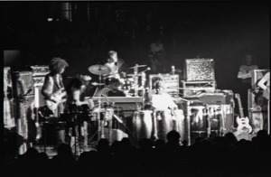 First page of Santana concert at the Springfield Civic Center: band in performance (blurred             and overexposed)