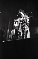 First page of Livingston Taylor in concert: Taylor seated with acoustic guitar
