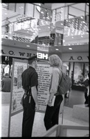 First page of Free Spirit Press crew member talking with police office in an indoor mall