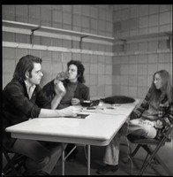 First page of Bob Weir sitting at table with Mitch Sieser and Anne Baker (l. to r.)