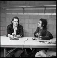 First page of Bob Weir sitting at table with Mitch Sieser (l. to r.)