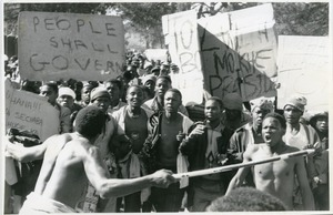 First page of Some of Basotho had peacefully marched to the Royal Palace before five             were shot dead and 15 injured last August 17 by Lesotho Defence Force (probably unrest             over 1998 elections)