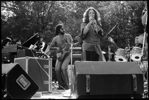 First page of Flora Purim (microphone) and band performing at Jazz Festival, Hampshire College Purim singing, with keyboardist, bass player, and drummer in background