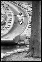 First page of Child descending a slide at a playground