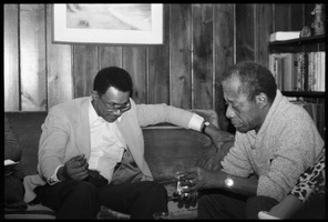 First page of James Baldwin (right) talking with David Graham Du Bois, at the book party for Robert H. Abel