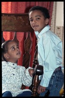 First page of Antonio and Zena Allen (children) posed in a oversized chair