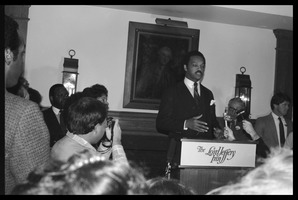 First page of Jesse Jackson at the podium, addressing supporters Reception for presidential candidate Jesse Jackson at the Lord Jeffery Inn