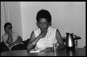 First page of Nancy Morejón, Cuban writer, speaking at the Institute for the Humanities, UMass Amherst, seated at a table for             discussion