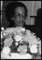 First page of Johnnetta Cole seated behind a basket of flowers at the 10th anniversary celebrations for Women's Studies at UMass Amherst