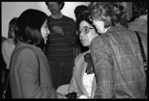 First page of Marysa Navarro (center) mingling at the reception for the 10th anniversary celebrations for Women's Studies at UMass Amherst