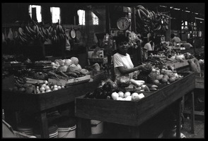 First page of Woman operating a market stall in the old marketplace, selling fruit, Belize City