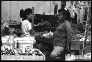 First page of Two women at a market stall selling produce in the old marketplace, Belize City