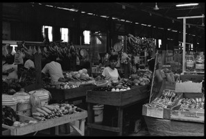 First page of Woman selling produce at a market stall in the old marketplace, Belize City