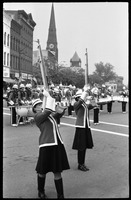 First page of Women performing with drill team and drum line, corner of Main Street and Crafts             Ave.
