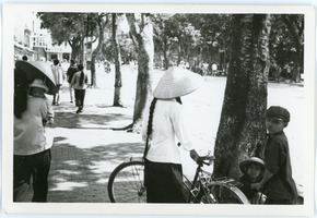 First page of Street scene near Hoan Kiem Lake, with family in foreground