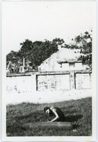 First page of Naomi Jaffe examining unexploded bomb, in front of ruins