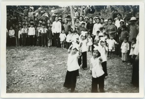 First page of School children dancing in assembly, a performance for foreign guests