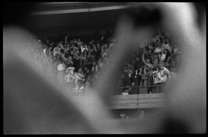 First page of Beatles concert at Shea Stadium: shot of the screaming crowd in the upper deck