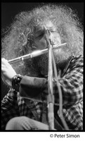 First page of Ian Anderson (Jethro Tull) playing flute (close-up), Newport Jazz Festival