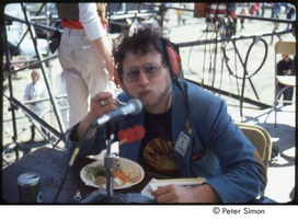 First page of MUSE concert and rally: Danny Schechter (l) with two unidentified journalists