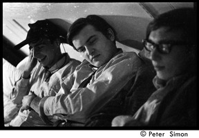 First page of Boston University News staff: Stephen Davis, Joe Pilati, and Clif Garboden (l.             to r.), lying back