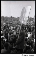 First page of Resistance on the Boston Common: shot of crowd of antiwar demonstrators, with             man holding large sign with Resistance symbol and reading 'Le chronic'