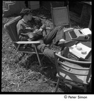 First page of 60 Chestnut Street: Stephen Davis seated in a lawn chair with puppy and             typewriter