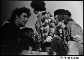 First page of Abbie Hoffman (left) talking with other protesters Moratorium to End the War in Vietnam protest on Boston Common
