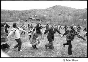 First page of May Day at Packer Corners commune: group holding hands and dancing
