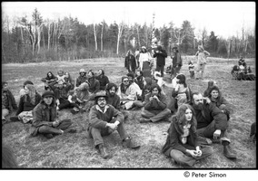First page of May Day at Packer Corners commune: group sitting and standing in a field