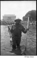 First page of Unidentified protestor wading in a Mall reflecting pool during the Poor People's Campaign Solidarity Day