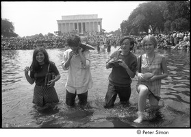 First page of Stephen Davis and Raymond Mungo with two unidentified women, wading in a Mall             reflecting pool during the Poor People's Campaign Solidarity Day